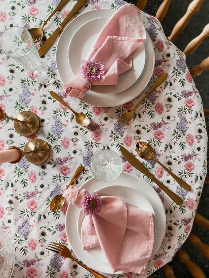 Mothers Day table setup with spring wild flowers and pink napkins